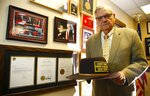 FILE - In this Aug. 26, 2019, file photo standing next to his presidential pardon from President Donald Trump, former Arizona Maricopa County Sheriff Joe Arpaio poses for a photograph as he announces his 2020 campaign for Maricopa County Sheriff in Fountain Hills, Ariz. Arpaio's primary defeat in his bid to win back the sheriff's post in metro Phoenix marks what's likely to be the 88-year-old's last political campaign. (AP Photo/Ross D. Franklin, File)