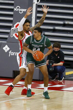Cleveland State's Torrey Patton, right, posts up against Ohio State's Musa Jallow during the second half of an NCAA college basketball game Sunday, Dec. 13, 2020, in Columbus, Ohio.  (AP Photo/Jay LaPrete)