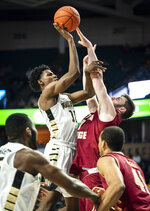 Wake Forest forward Jaylen Hoard (10) shoots over Boston College forward Nik Popovic (21) during an NCAA college basketball game, Saturday, Jan. 26, 2019, in Winston-Salem, N.C. (Andrew Dye/The Winston-Salem Journal via AP)