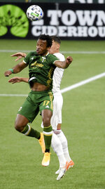 Portland Timbers forward Jeremy Ebobisse, left, and Real Salt Lake midfielder Damir Kreilach, right, go up for a ball during the first half of an MLS soccer match in Portland, Ore., Saturday, Aug. 29, 2020. P Photo/Steve Dykes)