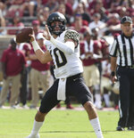 Wake Forest's Sam Hartman attempts a pass in the first quarter of an NCAA college football game with Florida State, Saturday, Oct. 20, 2018 in Tallahassee, Fla. (AP Photo/Steve Cannon)