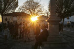 People gather at the historic Albaicin district in Granada, Spain, during sunset on Tuesday, March 12, 2019. The district was declared a UNESCO World Heritage Site in 1984. (AP Photo/Mosa'ab Elshamy)