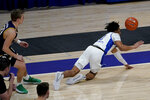 Pittsburgh's Ithiel Horton, right, loses the ball as he tumbles out of bounds in front of Notre Dame's Dane Goodwin during the first half of an NCAA college basketball game, Saturday, Jan. 30, 2021, in Pittsburgh. (AP Photo/Keith Srakocic)