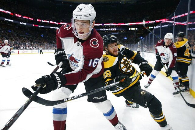 FILE - In this Dec. 7, 2019 file photo, Boston Bruins' David Pastrnak (88) works against Colorado Avalanche's Nikita Zadorov (16) during the second period of an NHL hockey game in Boston. The Avalanche acquired Brandon Saad in a multiplayer trade with the Chicago Blackhawks on Saturday, Oct. 10, 2020. Colorado sent Zadorov and Anton Lindholm to Chicago for Saad and defenseman Dennis Gilbert. The Blackhawks also will retain $1 million of Saad's $6 million salary for next season. (AP Photo/Michael Dwyer, File)
