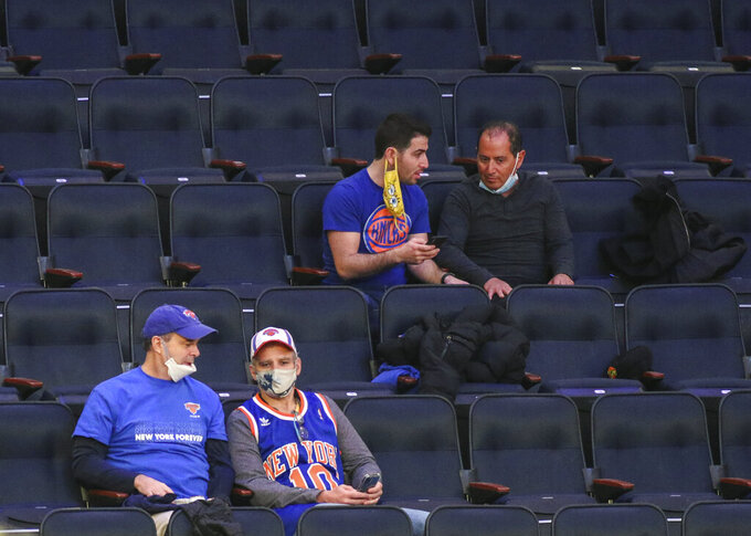 Fans wait for an NBA basketball game between the New York Knicks and the Golden State Warriors at Madison Square Garden on Tuesday, Feb. 23, 2021, in New York. (Wendell Cruz/Pool Photo via AP)
