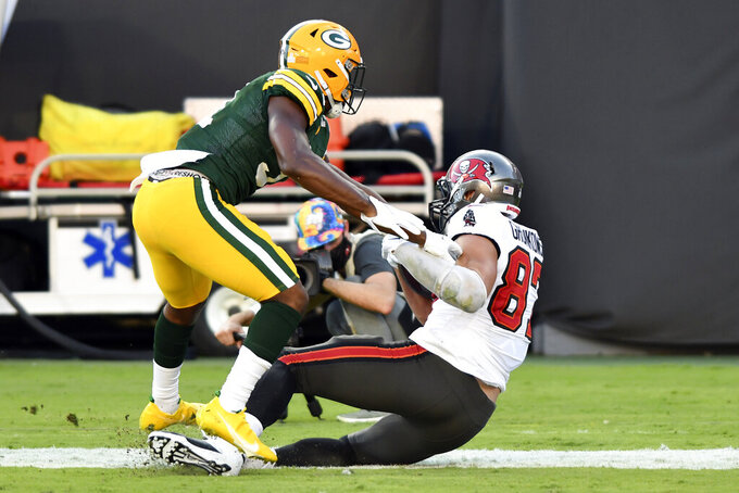 Tampa Bay Buccaneers tight end Rob Gronkowski (87) scores a touchdown in front of Green Bay Packers strong safety Adrian Amos (31) during the first half of an NFL football game Sunday, Oct. 18, 2020, in Tampa, Fla. (AP Photo/Jason Behnken)