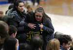 Young women console each other during a community vigil to honor the victims and survivors of yesterday's fatal shooting at the STEM School Highlands Ranch, on Wednesday, May 8, 2019, in Highlands Ranch, Colo. (AP Photo/David Zalubowski)