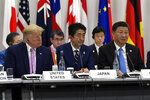President Donald Trump, Japanese Prime Minister Shinzo Abe and Chinese President Xi Jinping attend a session at the G-20 summit in Osaka, Japan, Friday, June 28, 2019. (AP Photo/Susan Walsh)