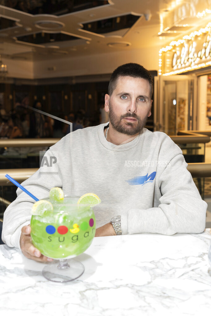 Scott Disick and Mario Lopez at The Grand Opening of the Sugar Factory