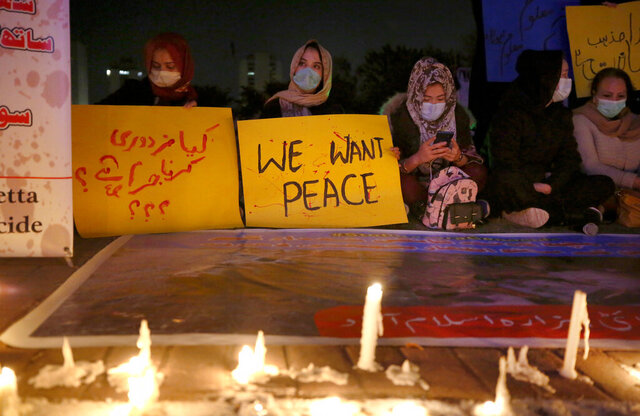Members of a civil society hold a candle light vigil for coal mine workers killed by gunmen near the Machh coal field, in Islamabad, Pakistan, Wednesday, Jan. 6, 2021. Pakistan's minority Shiites continued their sit-in for a fourth straight day insisting they will bury their dead only when Prime Minister Imran Khan personally visits them to assure protection. (AP Photo/Anjum Naveed)