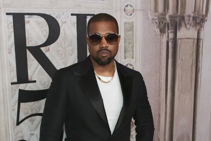 """FILE - In this Sept. 7, 2018, file photo, Kanye West attends the Ralph Lauren 50th Anniversary Event held at Bethesda Terrace in Central Park during New York Fashion Week in New York. West brought his collection of choir singers and musicians to an Atlanta-area megachurch for his religious popup performance called """"Sunday Service."""" News outlets reported West visited New Birth Missionary Baptist Church on Sunday, Sept. 15, 2019, drawing a large group of parishioners and celebrities. West's popup group has made various appearances on Sundays since January including a stop in Dayton, Ohio at a benefit event supporting the community affected by the mass shooting. (Photo by Brent N. Clarke/Invision/AP, File)"""