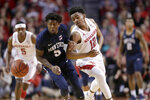 Penn State's Jamari Wheeler (5) and Nebraska's Thomas Allen (12) chase the loose ball during the first half of an NCAA college basketball game in Lincoln, Neb., Thursday, Jan. 10, 2019. (AP Photo/Nati Harnik)