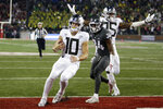 Oregon quarterback Justin Herbert (10) runs for a touchdown in front of Washington State safety Jalen Thompson (34) during the second half of an NCAA college football game in Pullman, Wash., Saturday, Oct. 20, 2018. Washington State won 34-20. (AP Photo/Young Kwak)