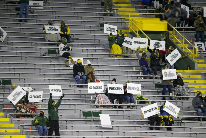 A limited number of fans watch during the second half of an NFL football game between the Green Bay Packers and the Philadelphia Eagles at Lambeau Field Sunday, Dec. 6, 2020, in Green Bay, Wis. (AP Photo/Mike Roemer)
