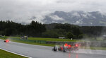 Red Bull driver Max Verstappen of the Netherlands steers his car in the rain during the qualifying for the Styrian Formula One Grand Prix at the Red Bull Ring racetrack in Spielberg, Austria, Saturday, July 11, 2020. The Styrian F1 Grand Prix will be held on Sunday. (Mark Thompson/Pool via AP)
