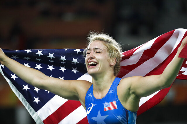FILE - In this Thursday, Aug. 18, 2016, file photo, United States' Helen Louise Maroulis celebrates after winning the gold medal during the women's 53-kg freestyle wrestling competition at the 2016 Summer Olympics in Rio de Janeiro. Maroulis was one of the most celebrated Olympians in 2016 when she became the first American to win a gold medal in women's wrestling, and she was expected to be one of the faces of the sport in Tokyo in 2020. She still might be if she's able to qualify. (AP Photo/Markus Schreiber, File)