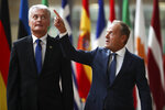 European Council President Donald Tusk, right, talks to Lithuania's Gitanas Nauseda before their meeting at the European Council headquarters in Brussels, Thursday, Sept. 5, 2019. (AP Photo/Francisco Seco)
