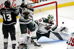 Minnesota Wild goaltender Cam Talbot, right, deflects a shot as defenseman Carson Soucy, center, defends against Los Angeles Kings center Gabriel Vilardi, left, during the first period of an NHL hockey game in Los Angeles, Thursday, Jan. 14, 2021. (AP Photo/Alex Gallardo)