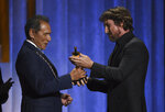 Christian Bale, right, presents an honorary award to Wes Studi at the Governors Awards on Sunday, Oct. 27, 2019, at the Dolby Ballroom in Los Angeles. (Photo by Chris Pizzello/Invision/AP)