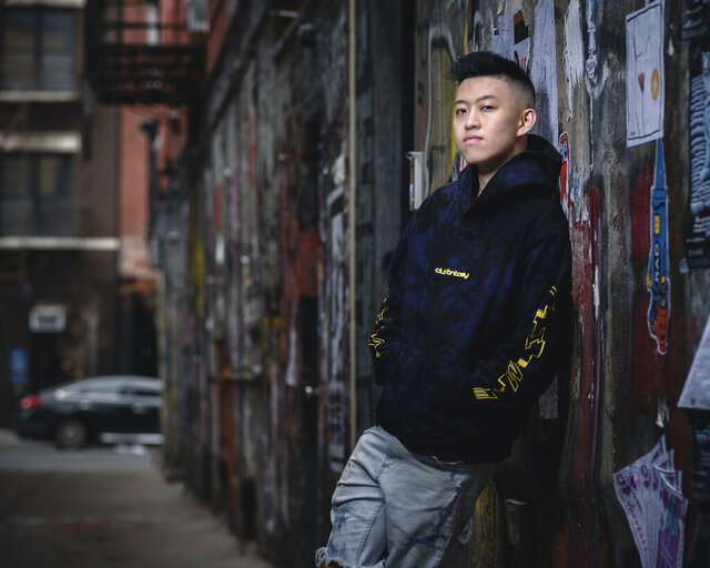 "This November 22, 2019, photo shows rapper Rich Brian posing for a portrait in New York. When he first started rapping, he was just a teen looking to make waves on SoundCloud. He had huge viral success with a song called ""Dat $tick,"" but also found controversy with a troubling moniker and a persona that some felt mocked hip-hop culture. A few years later, he's looking to prove he belongs in the rap world and has gained the respect of some key rap figures. (Photo by Christopher Smith/Invision/AP)"