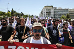 Protesters chant slogans during an anti-austerity rally in Athens, Thursday, June 14, 2018. Greece and its creditors are working on reaching a final deal next week on the country exiting its international bailout this summer, the European Commission's vice president said Thursday, adding that the bailout exit was