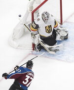 Colorado Avalanche's J.T. Compher (37) is stopped by Vegas Golden Knights goalie Robin Lehner (90) during the first period of an NHL Stanley Cup qualifying round game in Edmonton, Alberta, Saturday, Aug. 8, 2020.  (Jason Franson/The Canadian Press via AP)
