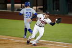 Los Angeles Dodgers' Mookie Betts is save at first past Atlanta Braves first baseman Freddie Freeman during the sixth inning in Game 5 of a baseball National League Championship Series Friday, Oct. 16, 2020, in Arlington, Texas. (AP Photo/Tony Gutierrez)