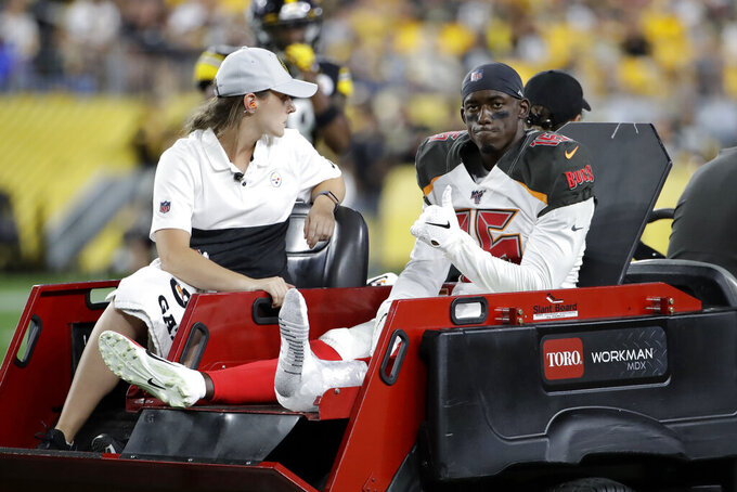 Tampa Bay Buccaneers wide receiver Bryant Mitchell (16) rides off the field after being injured during the second half of the team's NFL football game against the Pittsburgh Steelers in Pittsburgh, Friday, Aug. 9, 2019. (AP Photo/Don Wright)