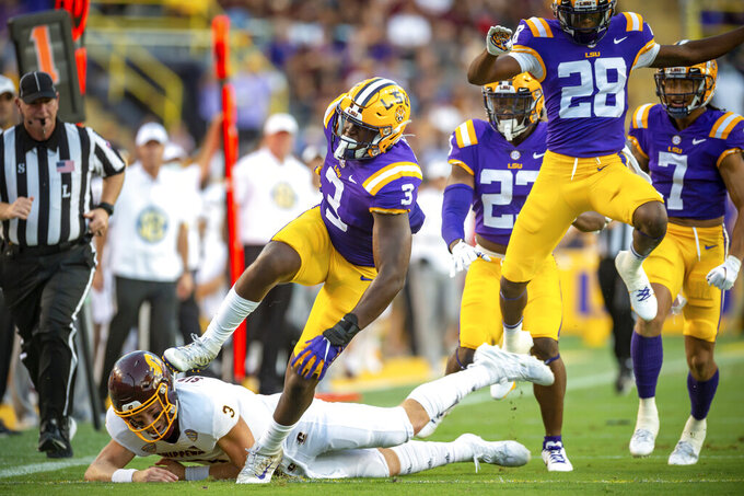 LSU's Andre Anthony runs back a fumble to score against Central Michigan during an NCAA college football game Saturday, Sept. 18, 2021, in Baton Rouge, La. (Scott Clause/The Daily Advertiser via AP)