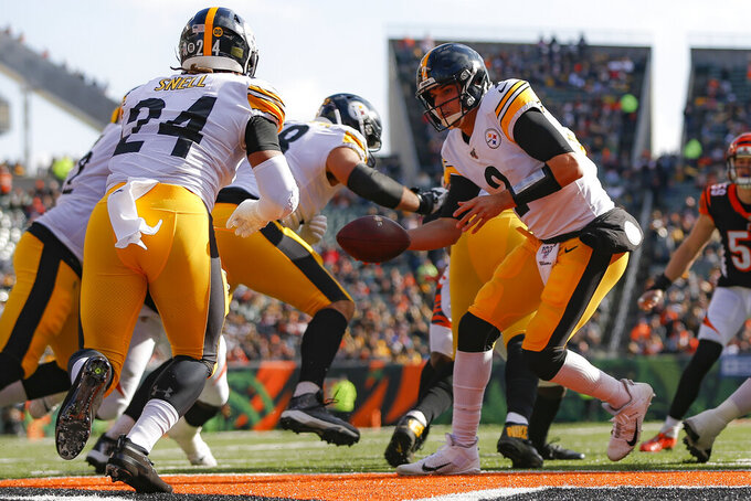 Pittsburgh Steelers quarterback Mason Rudolph (2) looks to hand off the ball during the first half an NFL football game against the Cincinnati Bengals, Sunday, Nov. 24, 2019, in Cincinnati. (AP Photo/Frank Victores)