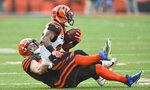 Cleveland Browns middle linebacker Joe Schobert, bottom, tackles Cincinnati Bengals running back Giovani Bernard during the first half of an NFL football game, Sunday, Dec. 8, 2019, in Cleveland. (AP Photo/David Richard)