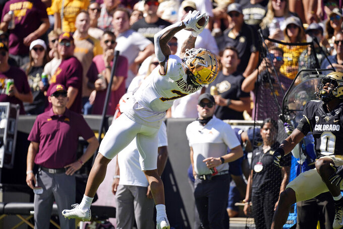 Minnesota wide receiver Chris Autman-Bell, left, pulls in a pass as Colorado safety Chris Miller defends in the first half of an NCAA college football game Saturday, Sept. 18, 2021, in Boulder, Colo. (AP Photo/David Zalubowski)