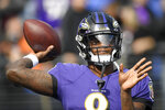 Baltimore Ravens quarterback Lamar Jackson works out prior to an NFL football game against the Cincinnati Bengals Sunday, Oct. 13, 2019, in Baltimore. (AP Photo/Nick Wass)