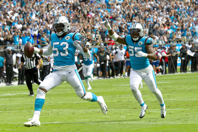 Carolina Panthers linebacker Brian Burns (53) runs into the end zone for a touchdown while defensive end Bruce Irvin (55) celebrates during the first half of an NFL football game in Charlotte, N.C., Sunday, Oct. 6, 2019. (AP Photo/Mike McCarn)