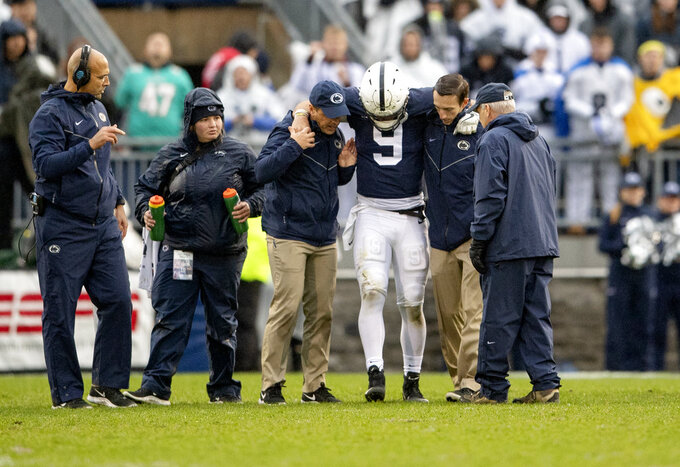 Penn State quarterback Trace McSorley gets helped off the field during the first half of an NCAA college football game against Iowa in State College, Pa., Saturday, Oct. 27, 2018. Penn State won, 30-24. (Abby Drey/Centre Daily Times via AP)