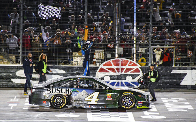 Kevin Harvick (4) celebrates after winning a NASCAR Cup Series auto race at Texas Motor Speedway, Sunday, Nov. 3, 2019, in Fort Worth, Texas. (AP Photo/Larry Papke)