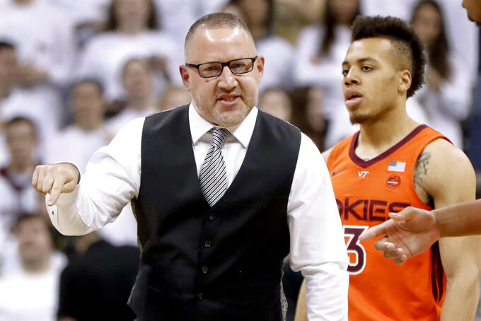 Virginia Tech head coach Buzz Williams, left, talks with his team at the start of the first half of an NCAA college basketball game against Pittsburgh, Saturday, Feb. 16, 2019, in Pittsburgh. Virginia Tech won 70-64. (AP Photo/Keith Srakocic)