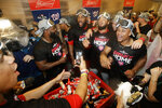 Washington Nationals celebrate in the locker room after their 7-3 win in 10 innings against the Los Angeles Dodgers in Game 5 of a baseball National League Division Series on Wednesday, Oct. 9, 2019, in Los Angeles. (AP Photo/Marcio Jose Sanchez)