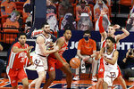 Illinois guard Jacob Grandison (3) passes the ball with help from teammate forward Giorgi Bezhanishvili (15) as Ohio State's forward Seth Towns (31), center Zed Key (23) and forward Justin Ahrens (10) defend during the first half of an NCAA college basketball game Saturday, Jan. 16, 2021, in Champaign, Ill. (AP Photo/Holly Hart)