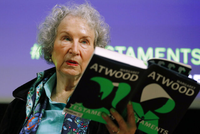 FILE - In this Sept. 10, 2019, file photo, Canadian author Margaret Atwood holds a copy of her book