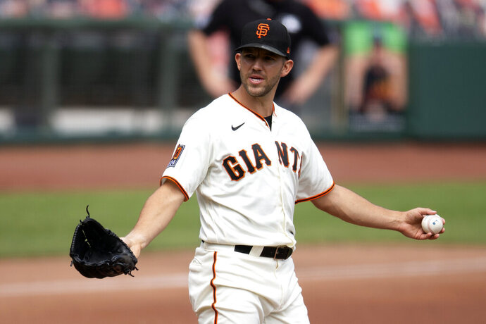 San Francisco Giants starting pitcher Tyler Anderson (31) reacts to comments from the Seattle Mariners dugout after he hit Kyle Seager with a pitch during the second inning of a baseball game, Thursday, Sept. 17, 2020 in San Francisco. (AP Photo/D. Ross Cameron)