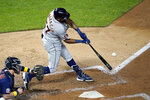 Detroit Tigers' Jorge Bonifacio hits an RBI single off Minnesota Twins pitcher Tyler Clippard during the seventh inning of a baseball game Saturday, Sept. 5, 2020, in Minneapolis. (AP Photo/Jim Mone)