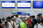 Stranded tourists line up in front of the Thomas Cook counter at the Cancun airport in Mexico, Monday, Sept. 23, 2019. British tour company Thomas Cook collapsed early Monday after failing to secure emergency funding, leaving tens of thousands of vacationers stranded abroad. (AP Photo/Victor Ruiz)