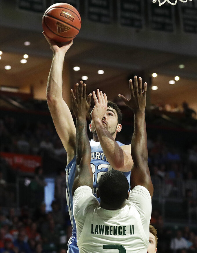 North Carolina forward Luke Maye shoots over Miami guard Anthony Lawrence II during the first half of an NCAA college basketball game on Saturday, Jan. 19, 2019, in Coral Gables, Fla. (AP Photo/Brynn Anderson)