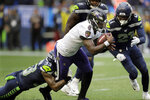 Baltimore Ravens quarterback Lamar Jackson keeps the ball for a touchdown on a fourth-down play against the Seattle Seahawks during the second half of an NFL football game, Sunday, Oct. 20, 2019, in Seattle. (AP Photo/John Froschauer)