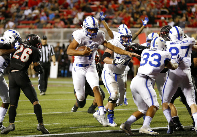Air Force quarterback Isaiah Sanders (4) crosses into the end zone on a quarterback keep play during the first half of an NCAA college football game in Las Vegas, Friday, Oct. 19, 2018. (Steve Marcus/Las Vegas Sun via AP)