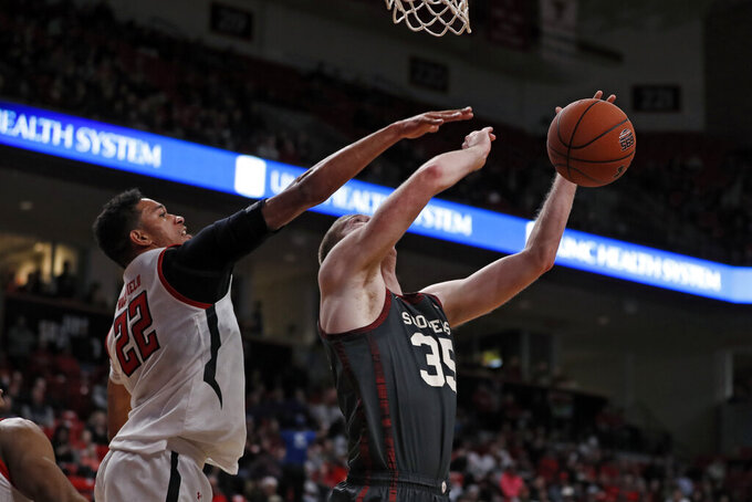 Texas Tech's TJ Holyfield (22) fouls Oklahoma's Brady Manek (35) as he shoots the ball during the first half of an NCAA college basketball game Tuesday, Feb. 4, 2020, in Lubbock, Texas. (Brad Tollefson/Lubbock Avalanche-Journal via AP)