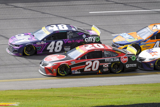 Alex Bowman (48) Christopher Bell (20) compete for the lead during a NASCAR Cup series auto race Monday, Oct. 4, 2021, in Talladega, Ala. (AP Photo/John Amis)