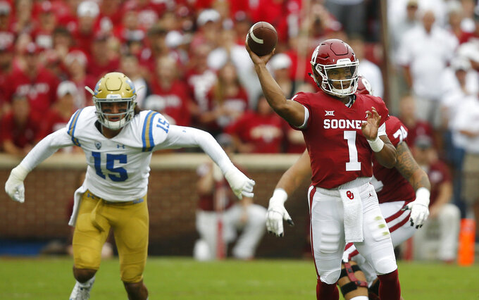 Murray's 5 total TDs lead No. 6 Oklahoma past UCLA 49-21