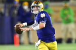 Notre Dame quarterback Ian Book looks for a receiver during the first quarter against Clemson in an NCAA college football game Saturday, Nov. 7, 2020, in South Bend, Ind. (Matt Cashore/Pool Photo via AP)